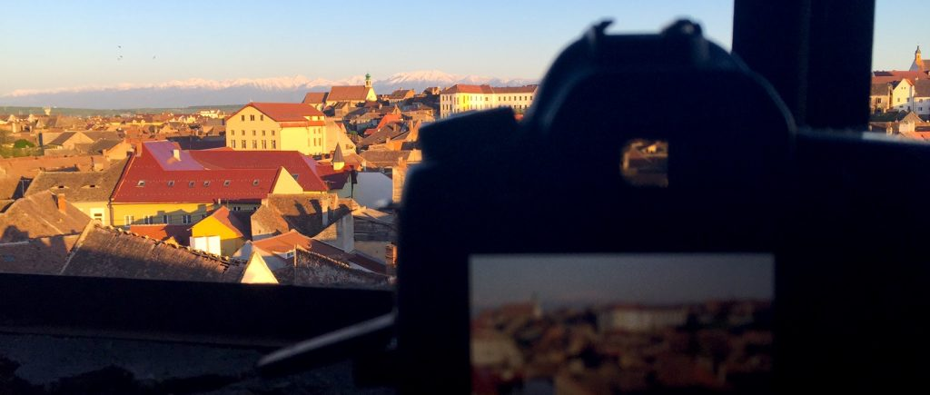 A view from an old school's attic in Sibiu - Fagaras mountains covered in snow in the background